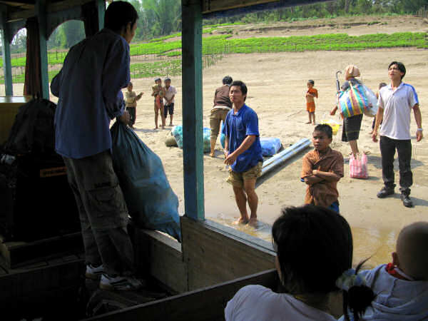 Laotian Mekong Slow Boat Unloading Freight and Passengers